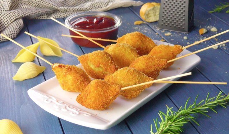 Хрустящие ракушки с нежной начинкой: идеальная горячая закуска.
